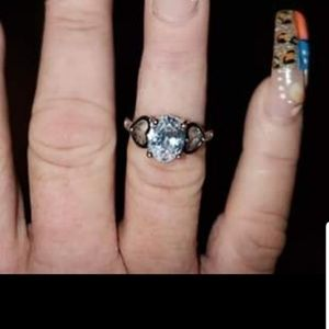 Silver diamond ring with hearts